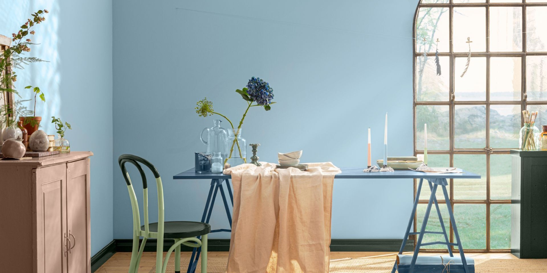 blue wall and table painted with green colours