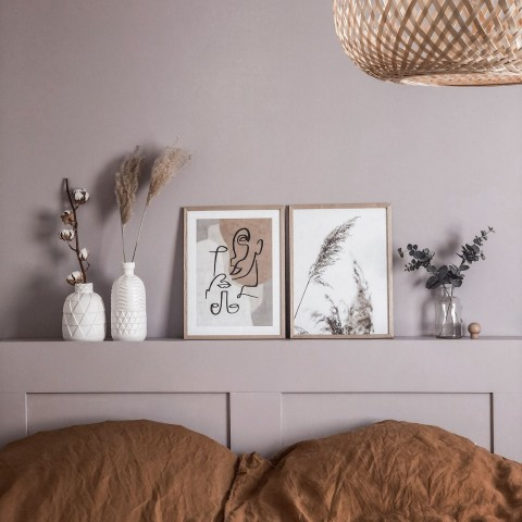 lilac colour wall and matching bed headboard